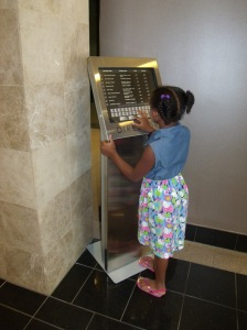 Kendall couldn't resist playing with the directory in Eddie's office building.