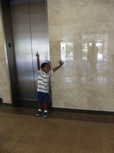 "Tre' was anxiously awaiting the elevator...He pushed the ""up"" button I don't know how many times."