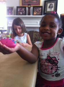 Arts & Crafts...Kendall showing off her bejeweled rock.