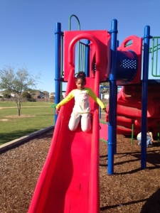 Kendall sliding down the slide