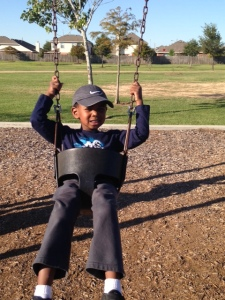 Tre' on the swing